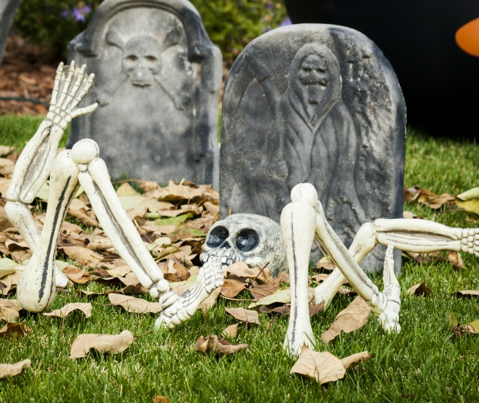Skeleton and gravestones with leaves