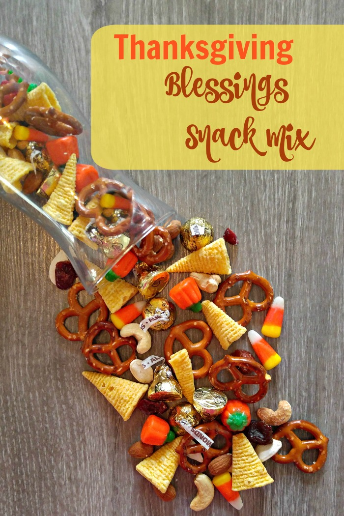 Tasty trail mix, pouring out of a bag with words reading Thanksgiving Blessings Snack Mix.
