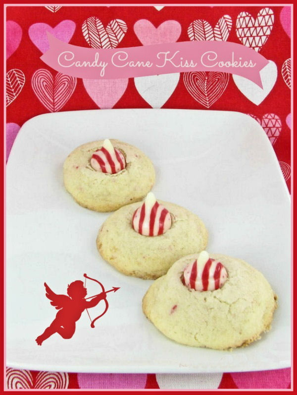 These Valentine's Day kiss cookies have a sugar cookie base and striped peppermint kiss on top