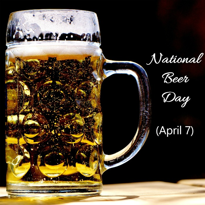 National beer day written on a photo of a mug of beer against a black background.