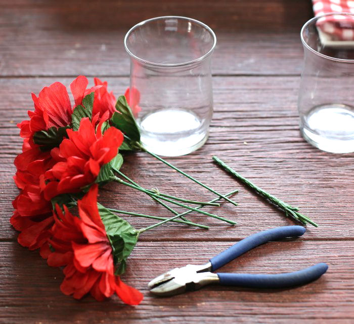 Cutting silk flowers with wire cutters