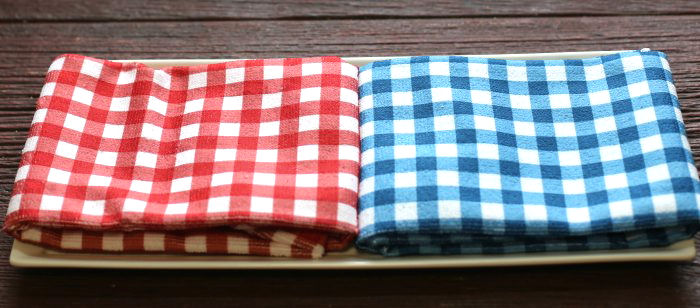 Red white and blue towels on a white plate