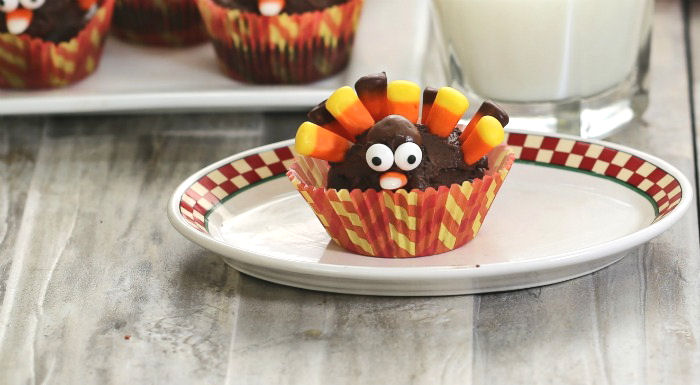 Chocolate cupcake in a fancy liner made into the shape of a turkey.