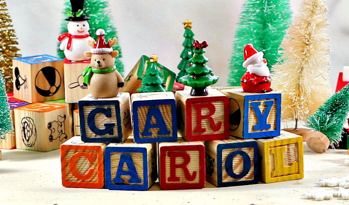alphabet blocks with names Gary and Carol with Christmas toys.