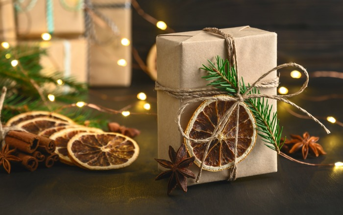 Eco-friendly package with greenery, dried citrus and star anise.