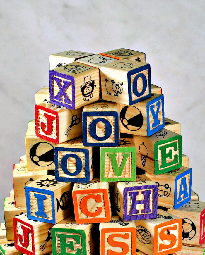 Words and names spelled out in a block Christmas tree.