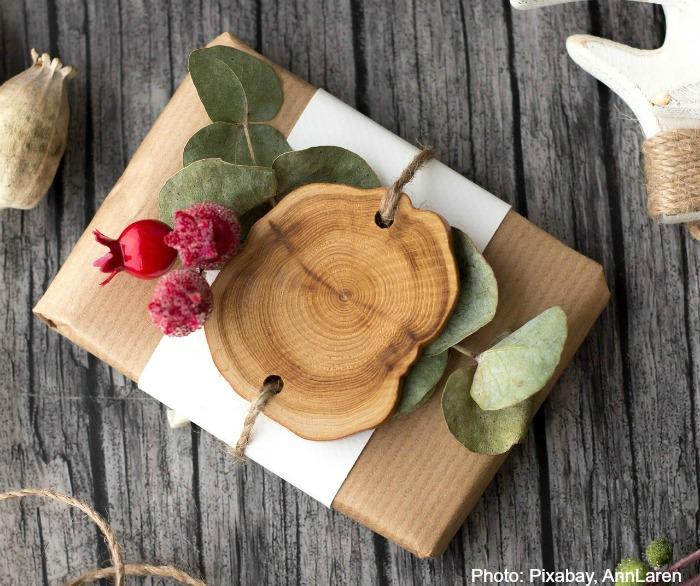 Christmas gift with eucalyptus, wood and seeds.