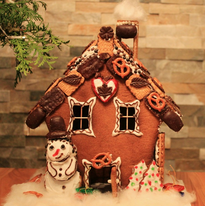 Gingerbread house with cookies and pretzels