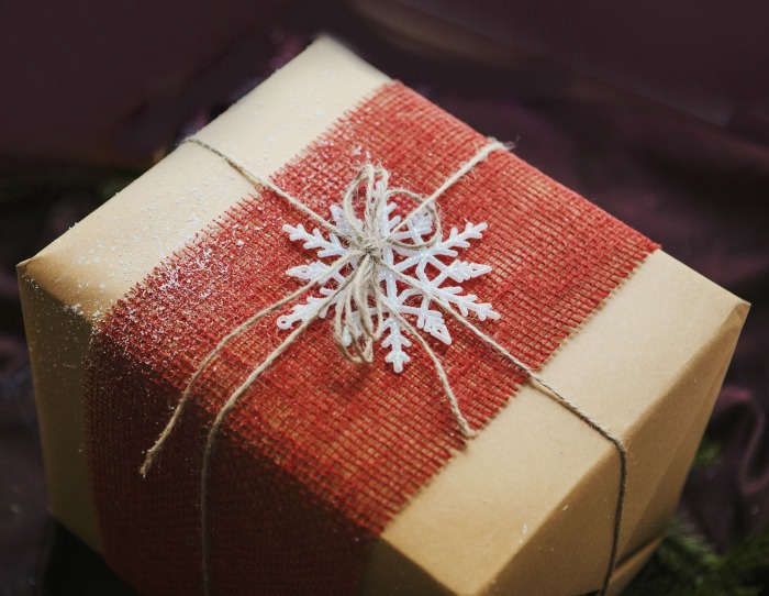 Christmas gift with red burlap ribbon and a three dimensional snowflake.