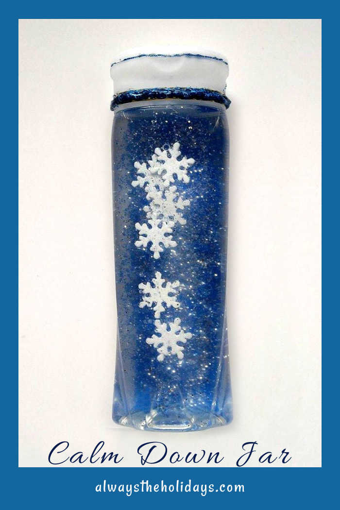 """Blue bottle with snowflakes and glitter and words """"calm down jar."""""""