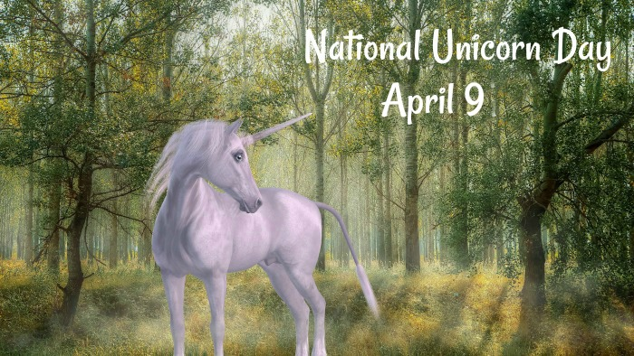 """A unicorn in the forest with """"National Unicorn Day April 9"""" written in the top right corner."""