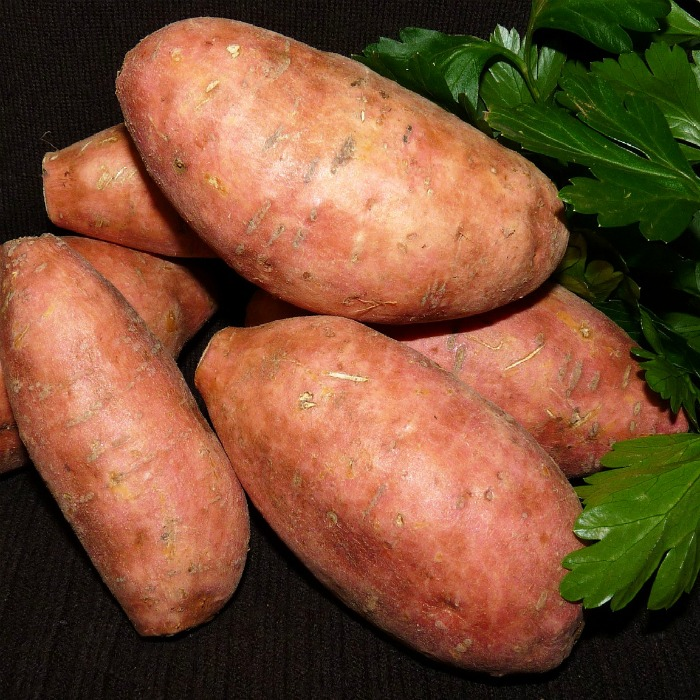 A close shot of sweet potatoes against a background.