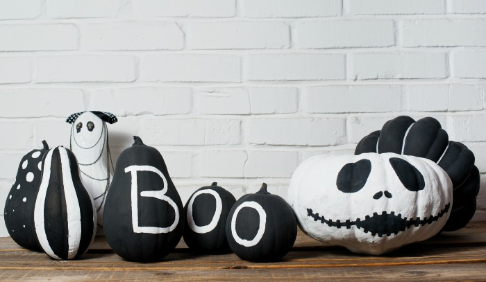 Painted heirloom pumpkins in black and white colors.