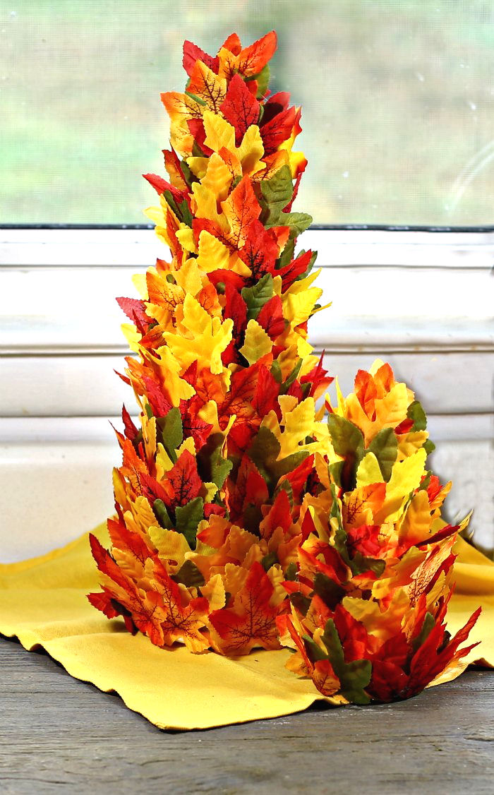Two DIY tree centerpiece on a yellow napkin.