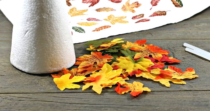 Variety of silk leaves with a foam cone and glue sticks.