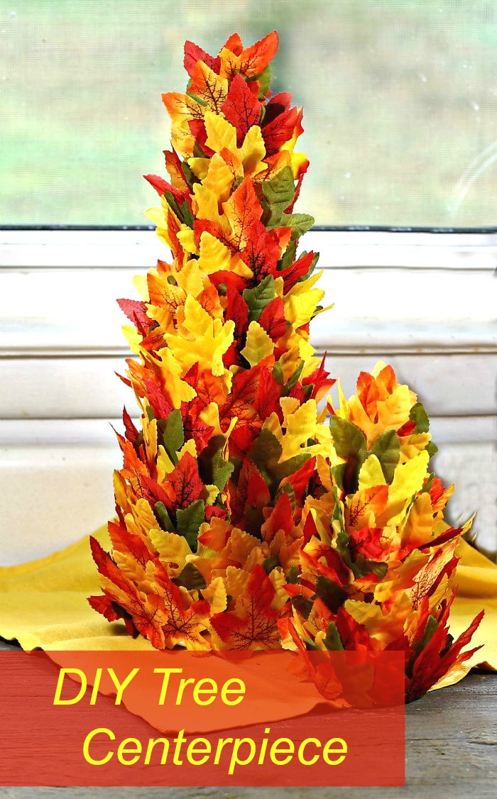 "Two cones covered in silk leaves with words reading ""DIY tree centerpiece."""