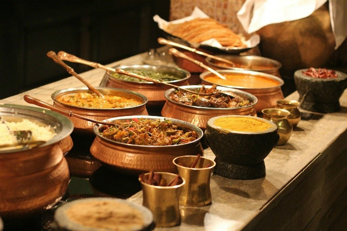 Table laden with Indian curries