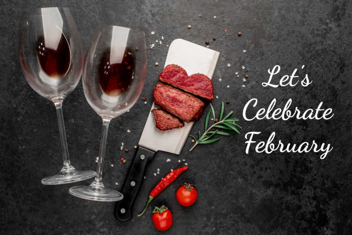 "Wine glasses, food on a meat cleaver, rosemary sprig, chili and tomatoes with words reading ""Let's celebrate February."""