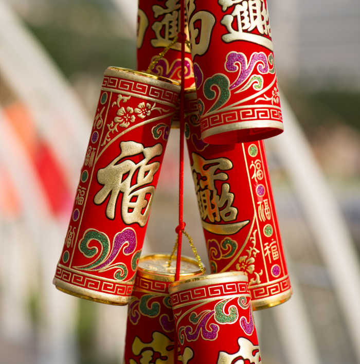 Chinese golden firecrackers hanging in a row.