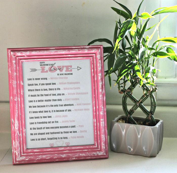 Framed messages of love in a pink frame.