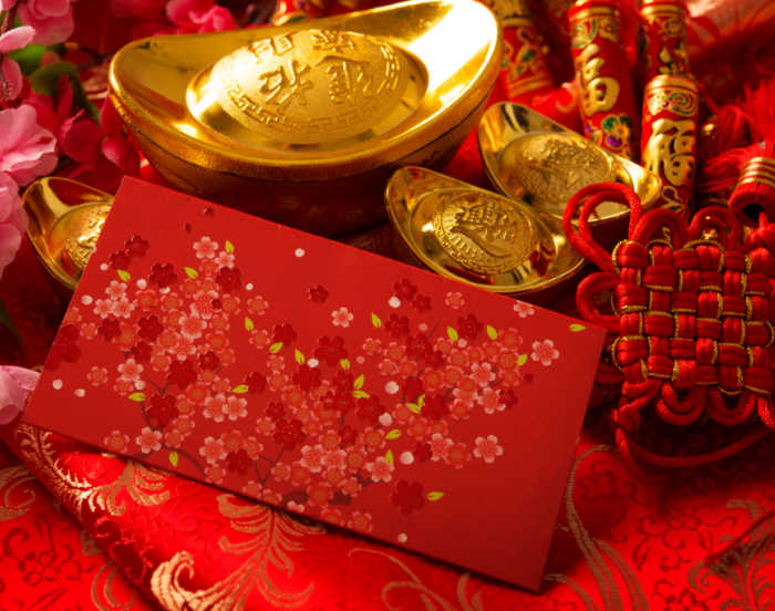 Red and gold decorations and money envelopes.