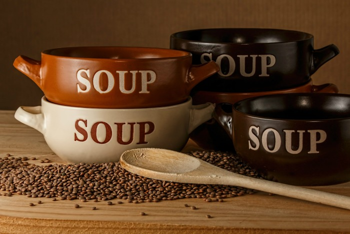 Soup bowls and lentils with a spoon