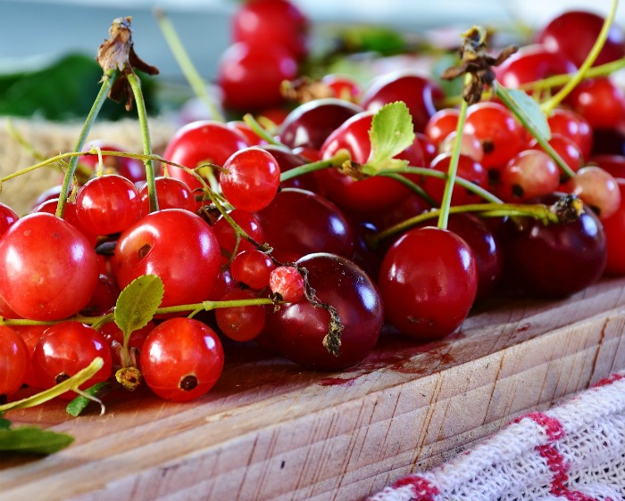 Sour cherries on a wooden board