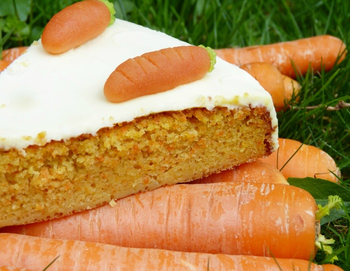 Carrot cake on a pile of carrots