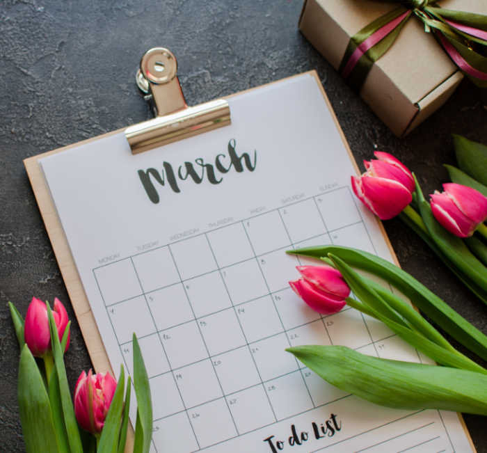 Calendar of March with tulips and box with ribbon.