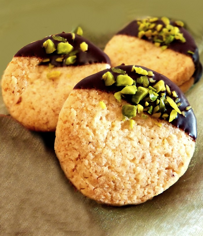 Shortbreads dipped in chocolate and pistachios