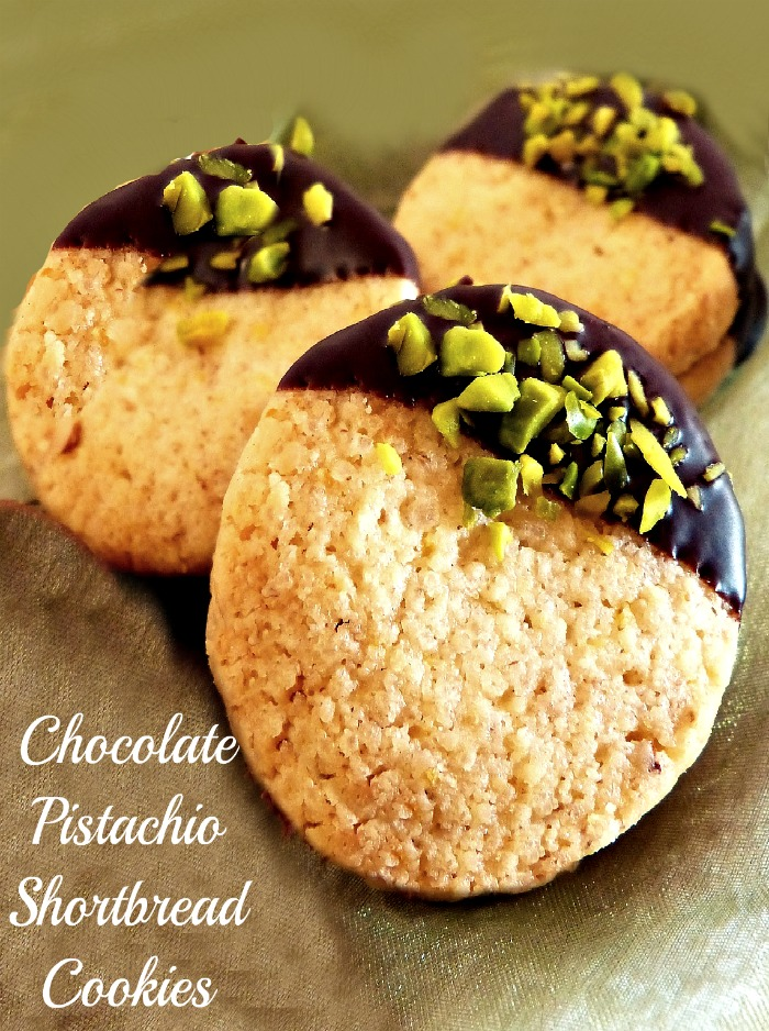These chocolate pistachio dipped cookies are tasty and full of texture. Make some for your next cookie swap. #shortbreadcookies #pistachiocookies #pistachiochocolate #cookierecipes #cookies