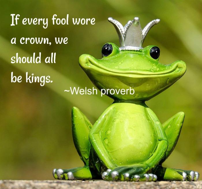 A fake green frog with a silver crown and an April Fool's Day quote text overlay.