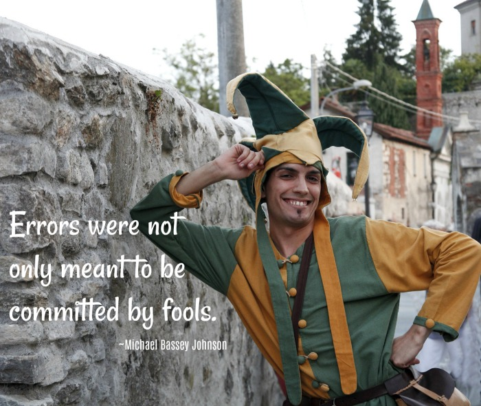 Jester quote for April Fool's Day on top of a photo of a man dressed as a jester at an amusement park.