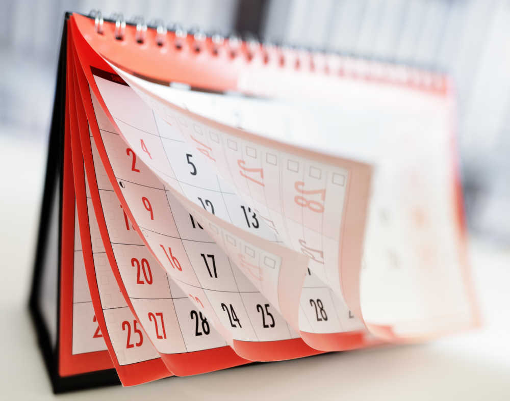 Pages of a red calendar opening up.