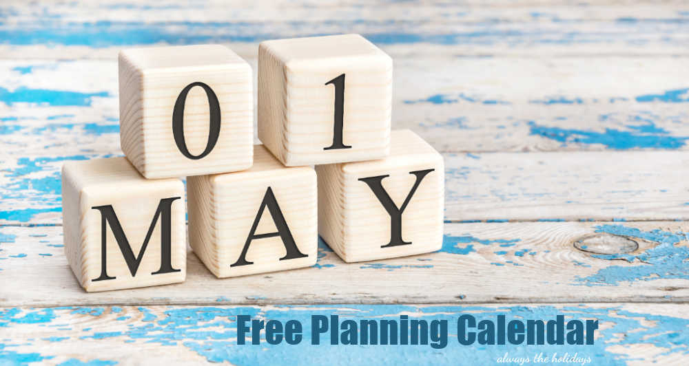 White blocks on teal weathered wood with date May 1 and words Free Planning Calendar.