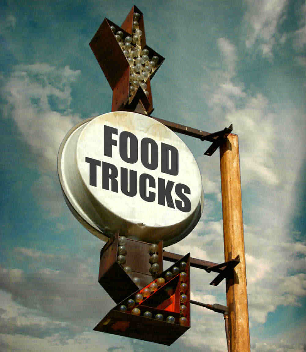 Lighted signs with arrow and words Food Trucks.