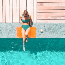 relaxing poolside in a bikini