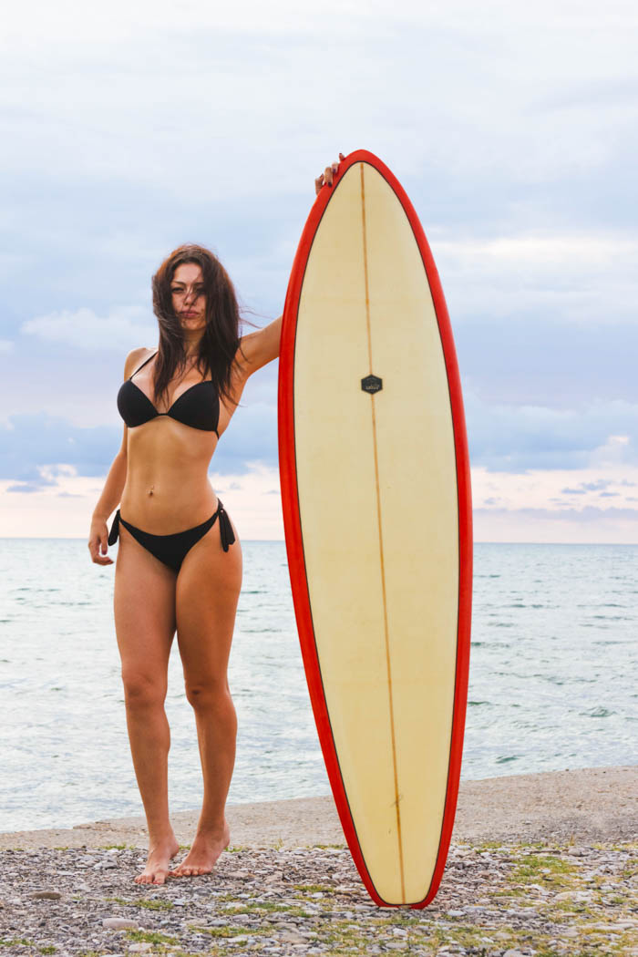 brunette bikini surfer girl