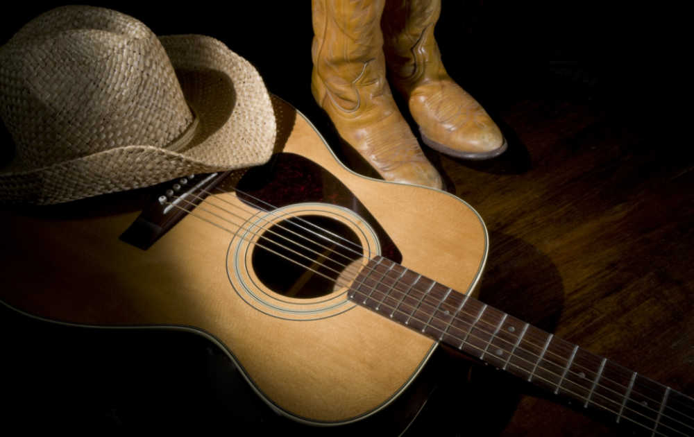 Guitar hat, boots and guitar.