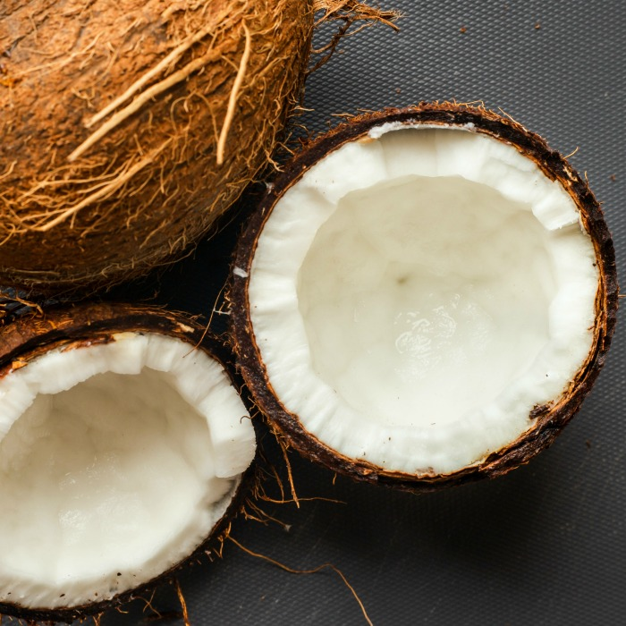 coconuts split with a whole coconut husk