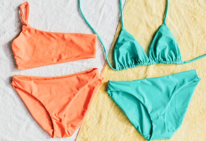 two pairs of neon bikinis