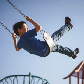 boy on swingset