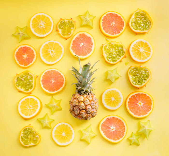 bright yellow citrus and pineapple collage