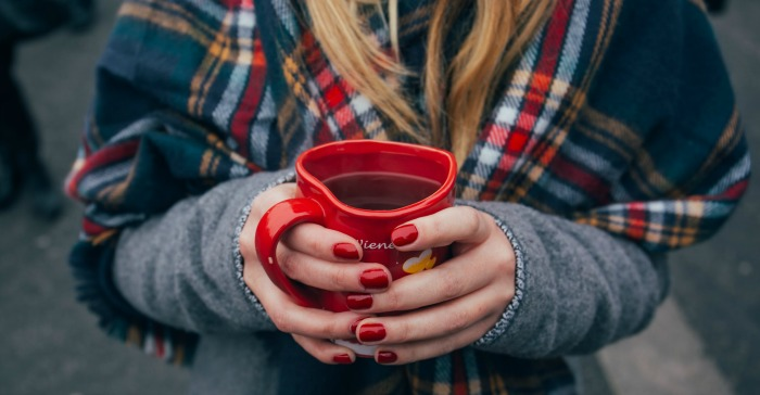Girl holding a cup of coffee