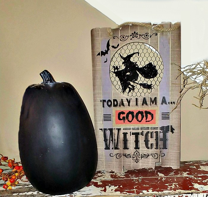 Black pumpkin and good witch sign