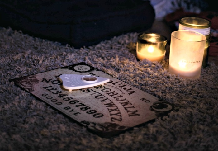 Ouija board and candles