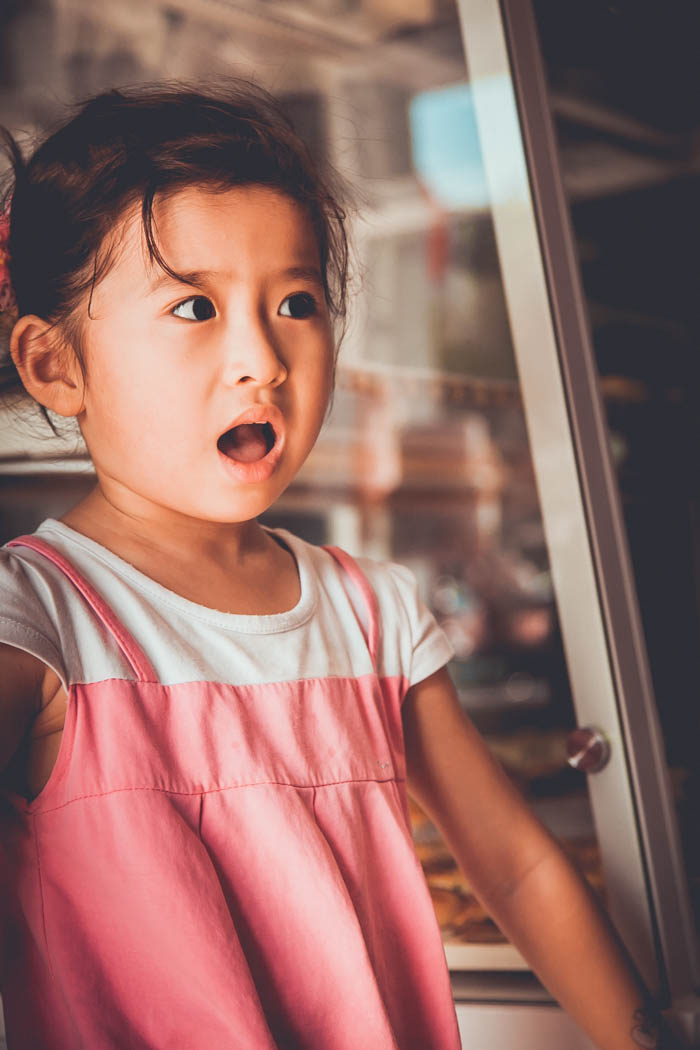 little girl who is surprised by gossip