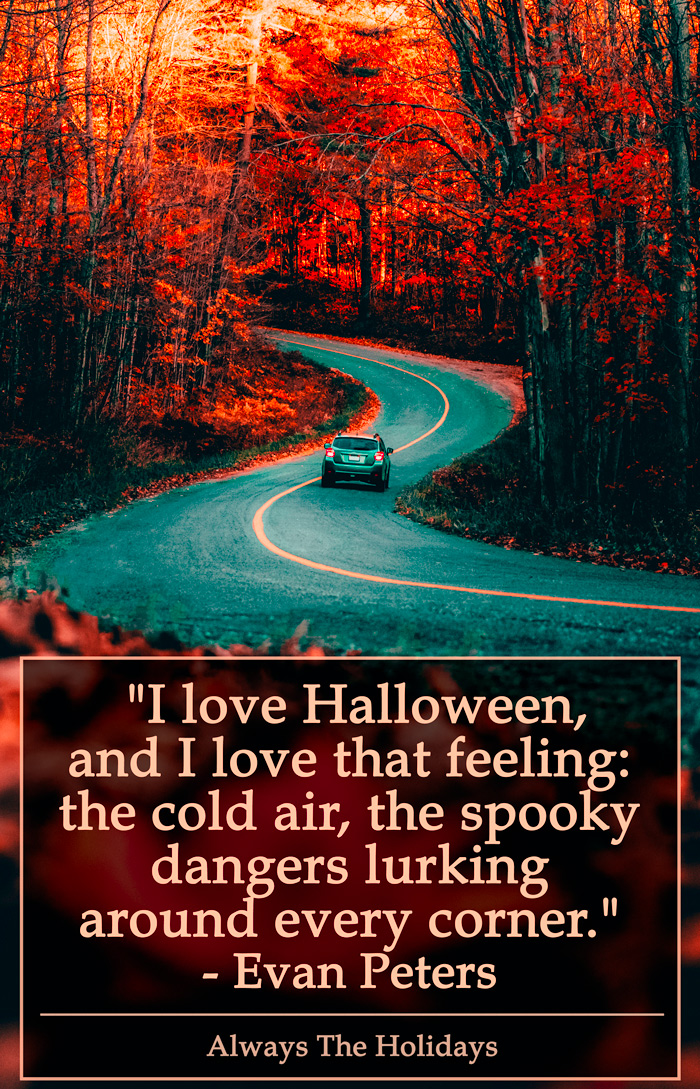 A car driving down a winding road in the fall with a quote about Halloween on it.