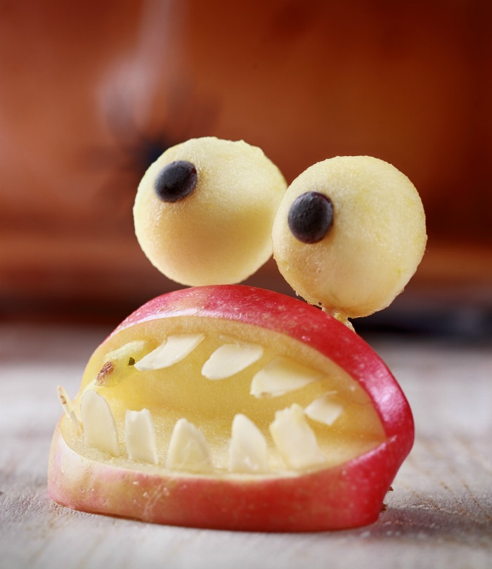 Apple mouth with slivered almond teeth and apple eyeballs.
