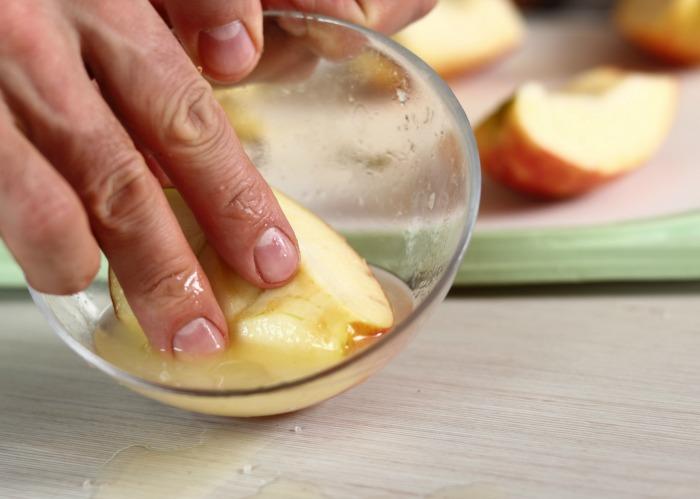 Dip apples in lemon juice